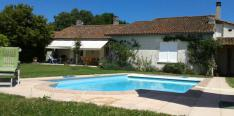 Well-maintained and quietly situated fermette with large garden, swimming pool and orchard