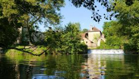 Old water mill with private residence, gîte, small camping site and outbuildings on 5,6 hectares (13.4 acres) of land at a small river rich in fish.