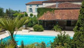 Beautiful mansion for sale in Charente with pool and barns