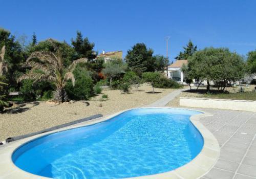 Te koop mooie villa op de begane grond met zwembad for Palme de piscine